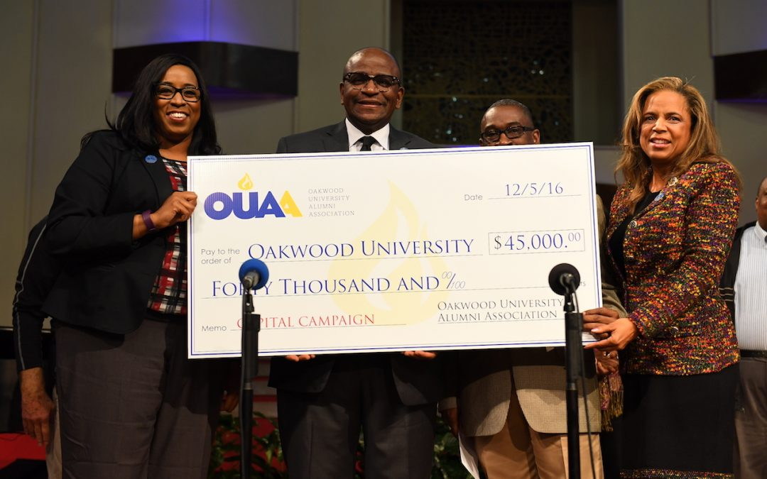 A check from representatives of the Oakwood University Alumni Association
